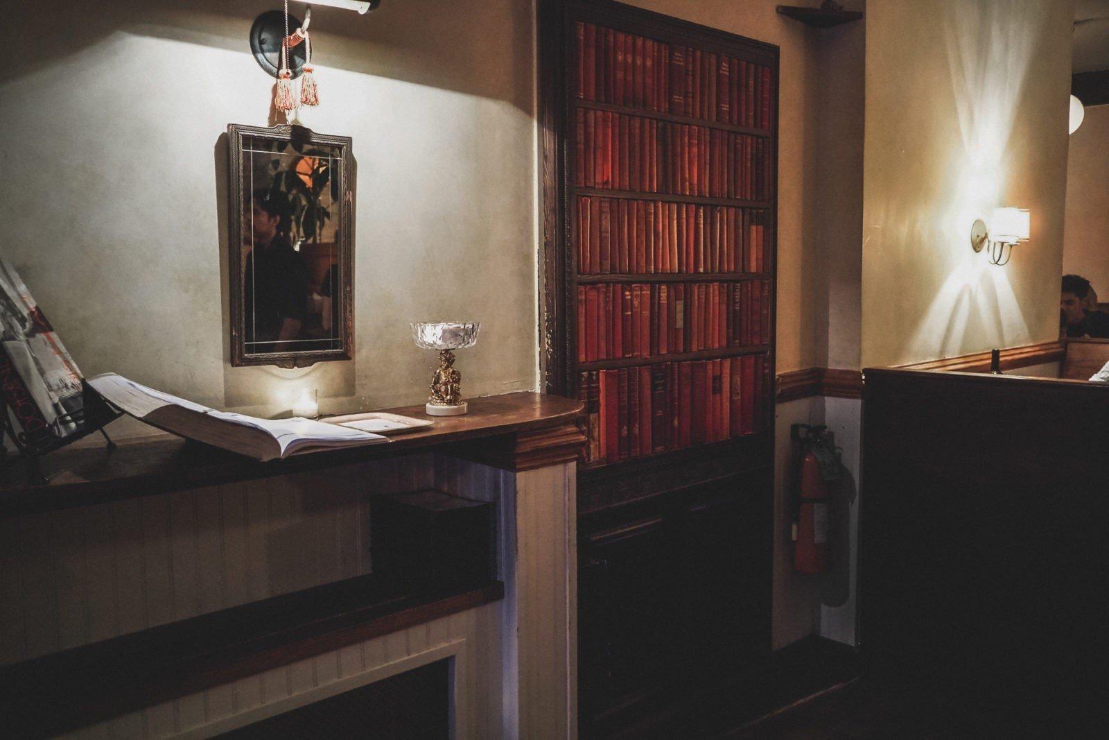 The hidden bookcase entrance to Le Boudoir